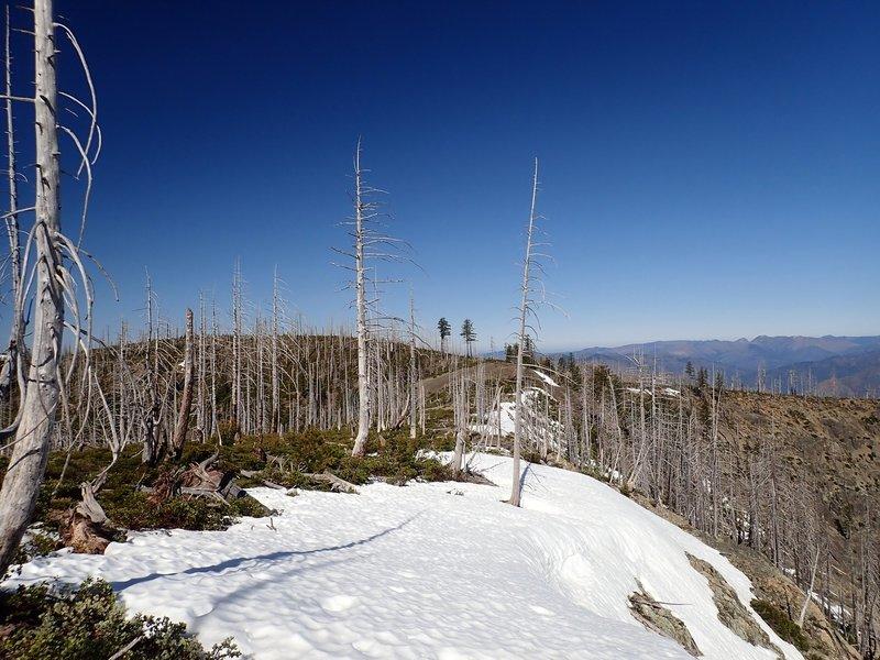 Snow lingers on the rim