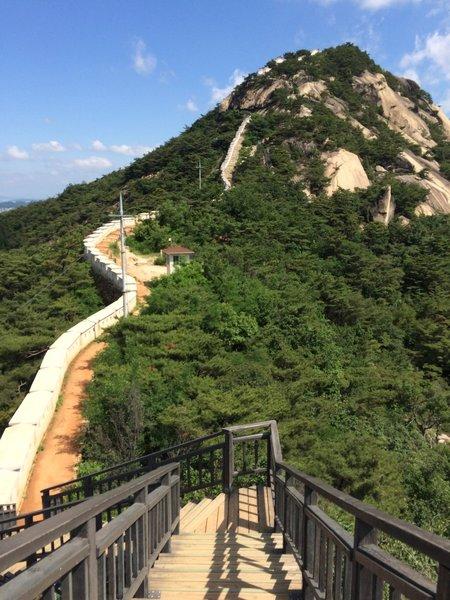 Wall climbing to mountain top