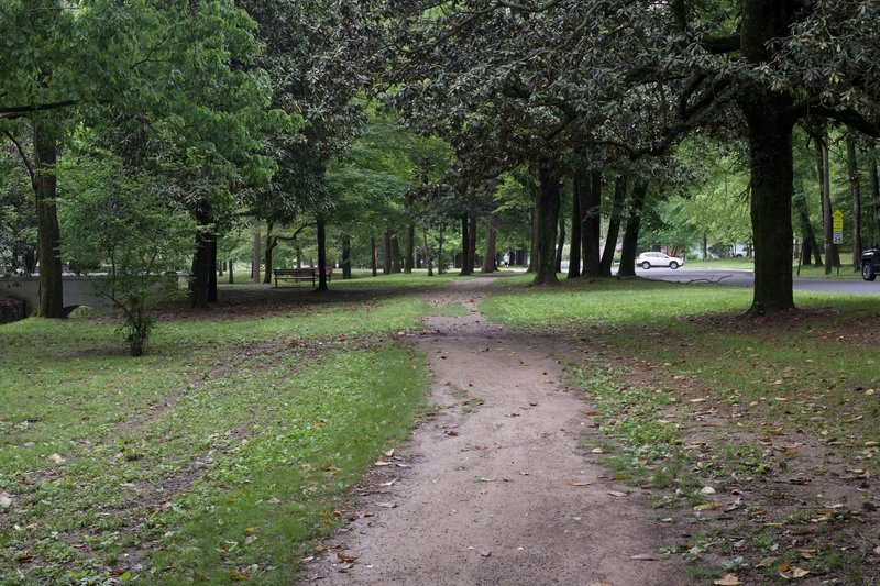 The dirt and gravel Whittington Trail runs underneath the shade of Magnolia and other native trees of Arkansas.