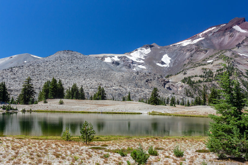 Green Lakes and South Sister covered in patchy snow.
