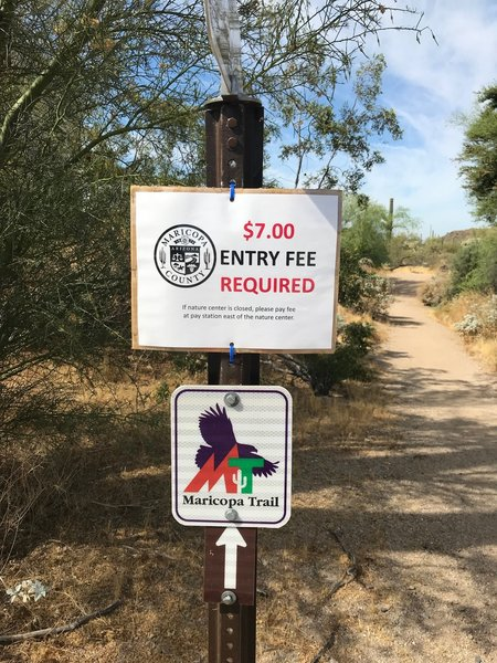 Remember to pay the parking fee if you start within the park. Example of the Maricopa Trail badge and arrow that you should follow.