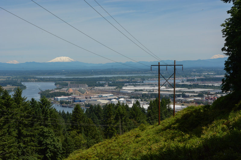 Rainier, Helens, and Adams from the BPA Road Trail, along with the confluence of the Willamette and Columbia Rivers. The power lines are ugly but the views make up for it