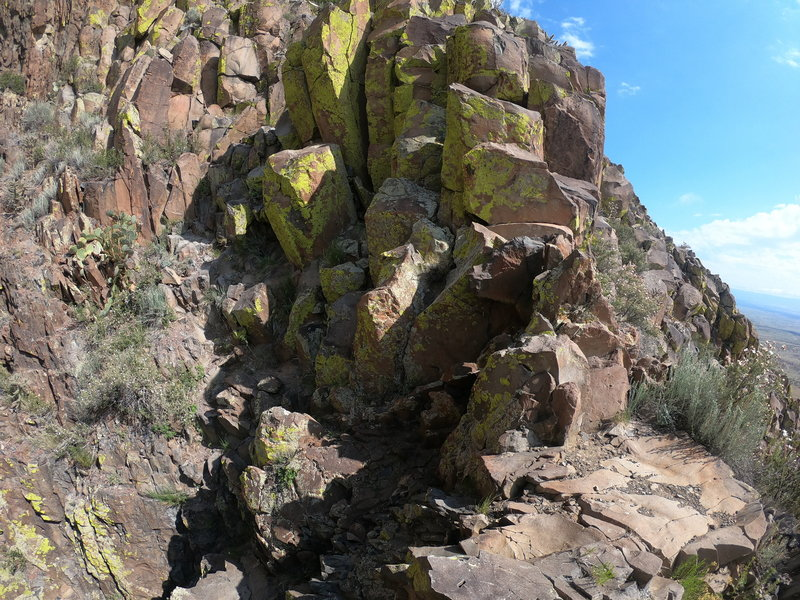 It is a Class II scramble up these rocks after the gully.