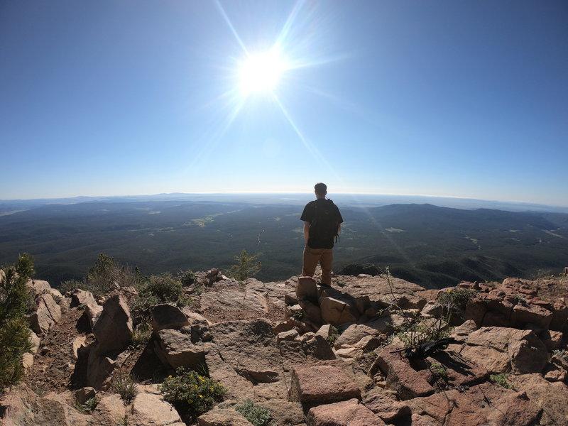 Enjoying the views at the edge of Hermit's Peak.