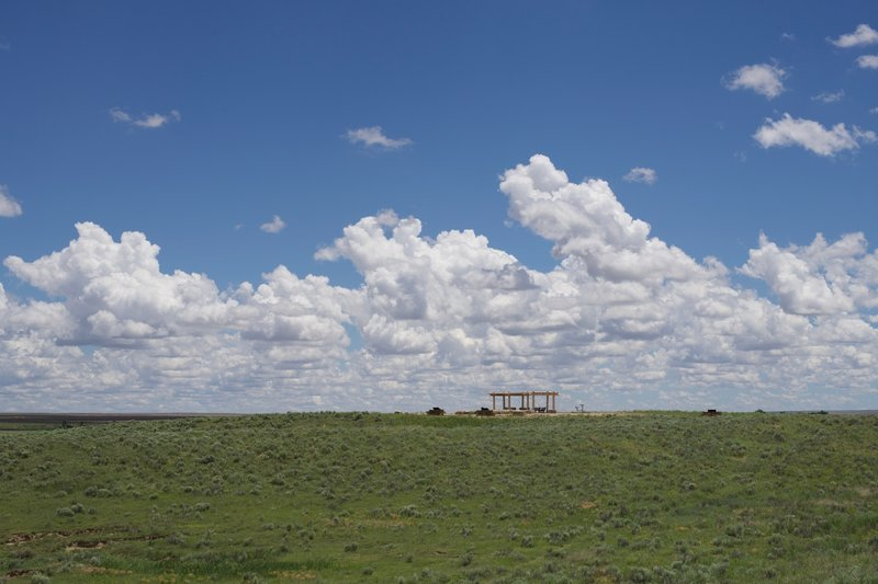 The views from the trail are stunning, especially if there are clouds in the sky. Looking back at the monument from the trail really conveys the vastness of the plains.