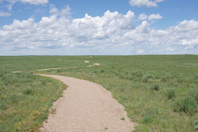 You can see the trail meandering through the high plains. You'll notice there is no shade, so make sure to bring plenty of water, apply sunscreen, and wear a hat.