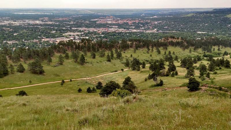 A view of the Dakota Ridge Trail and the wider Sanitas Valley Trail, as seen from the East Ridge Trail partway up Mt Sanitas.