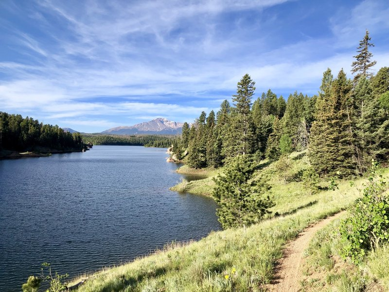 Trail bends around the reservoir and you can see Pikes Peak and Almagre in the distance.