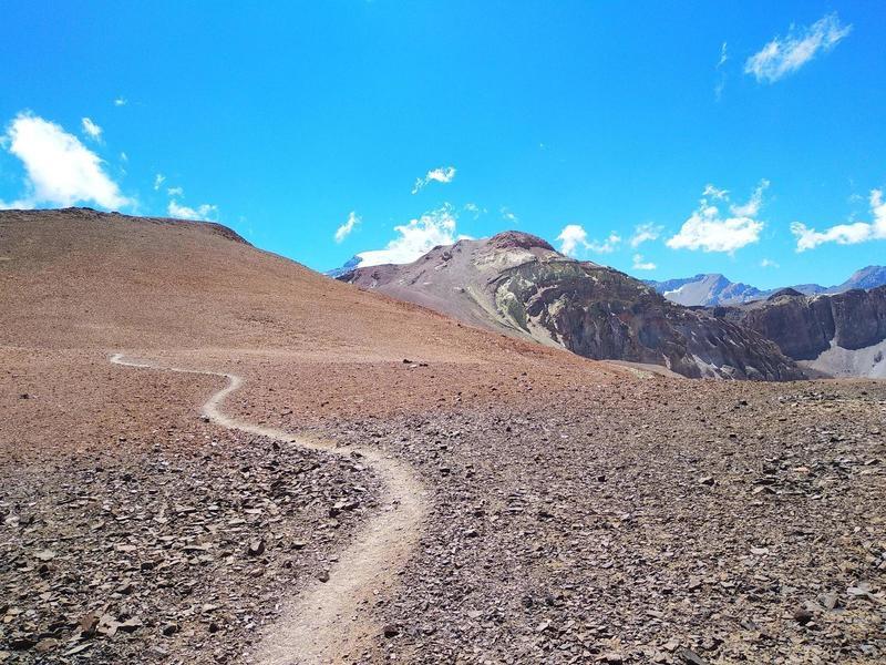 Flowing trail through looking towards Cerro Parva