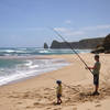 Father and son fishing at Gibson Beach well away from the tourists