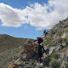 Hikers descending into Smoke Tree Canyon on a tricky stretch of trail