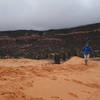 Hiker caught in a late spring hail storm at Coral Pink Sand Dunes SP