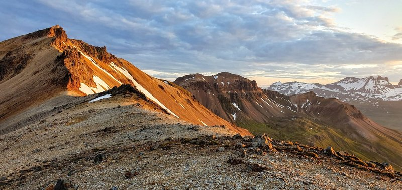 Top of Gagnheiði at midnight in summer. Staðarfjall in right side midground and Dyrfjöll in right side background.