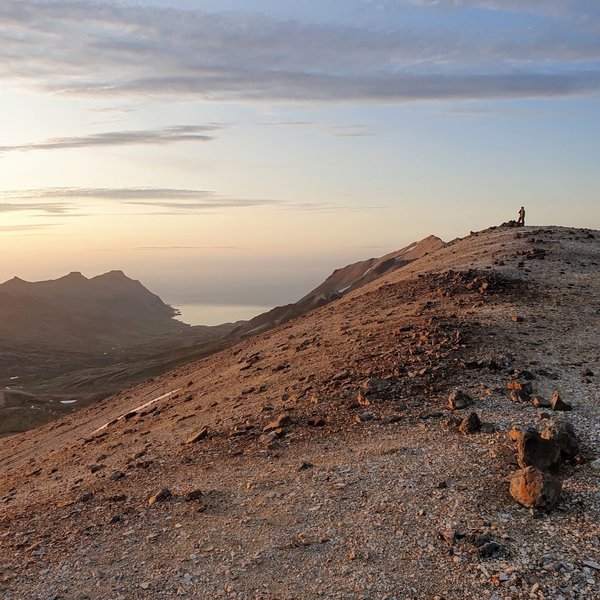 Standing on top of Gagnheiði looking at the midnight sun.