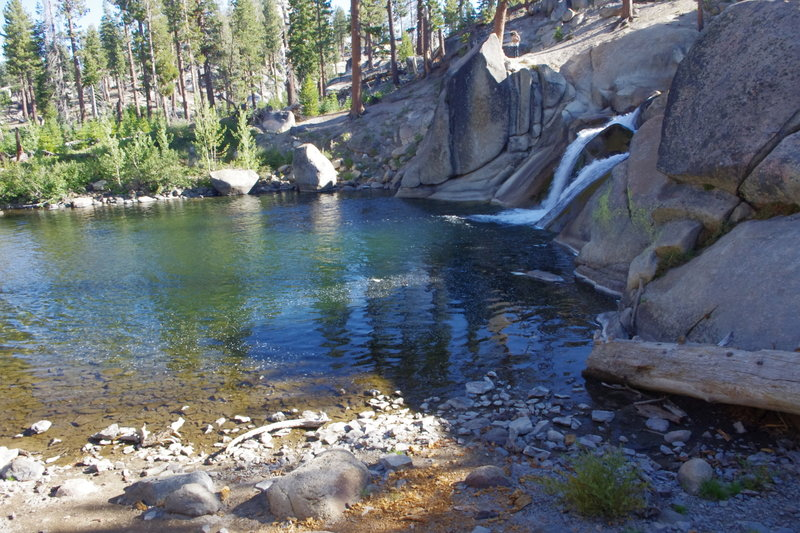 Walking from the top of Lower Rainbow Falls to the top of pond. Water changes every year in volume. Waterfall height about 25 feet. Jumping from top is generally safe ... pond about 11+ feet in depth. Trout fishing is about average.
