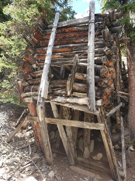 Abandoned and collapsed mine heading up the Mayflower Gulch Trail.