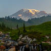 Looking up to Mount Rainier at sunrise from the bridge above Myrtle Falls.
