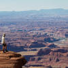 The view down to the Colorado River from Dead Horse Point (wife for scale).