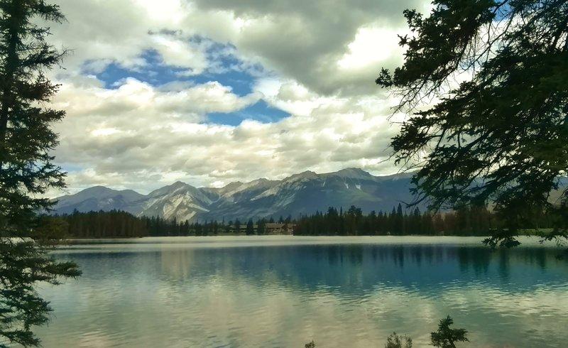 Lac Beauvert. Jasper Park Lodge, established in 1922, is on the opposite shore (center).