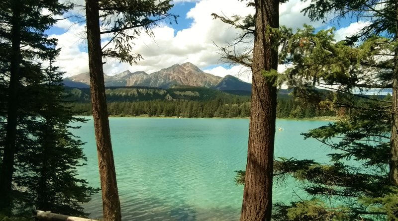 The turquoise waters of Lake Annette with Pyramid Mountain in the distance (center).