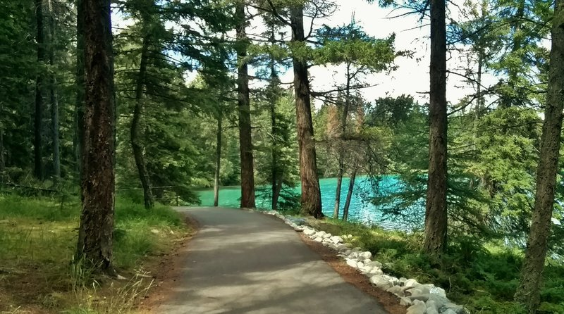 The wooded, 2.6 km (1.6 mile), ADA accessible trail around beautiful, turquoise Lake Annette.