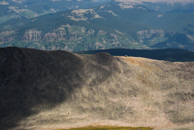 Tiny hut on a ridge below the summit