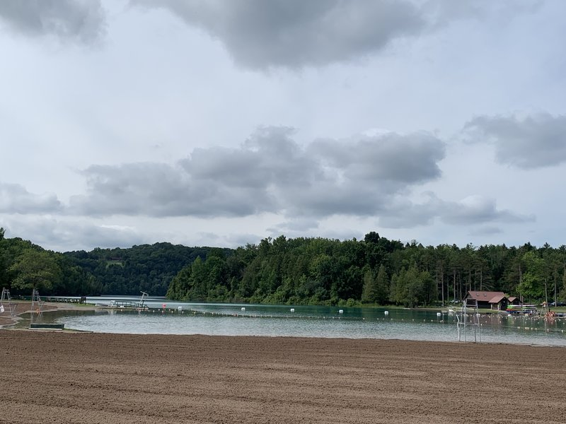 The groomed beach of the well-managed swimming area of Green Lake.