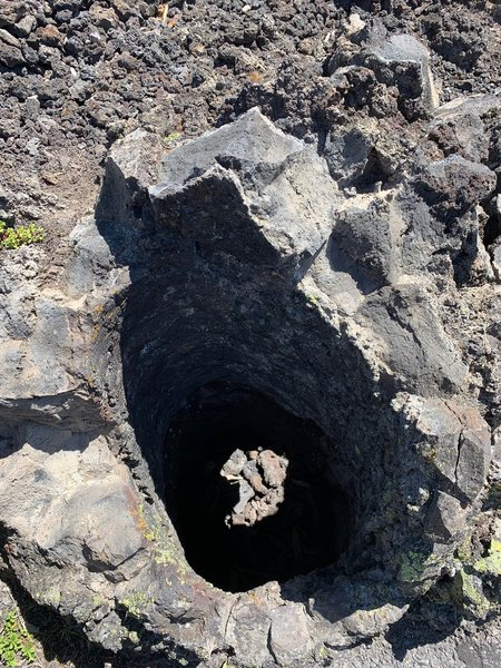 A vertical cast made from lava cooling around a tree, which then burned and rotted away.