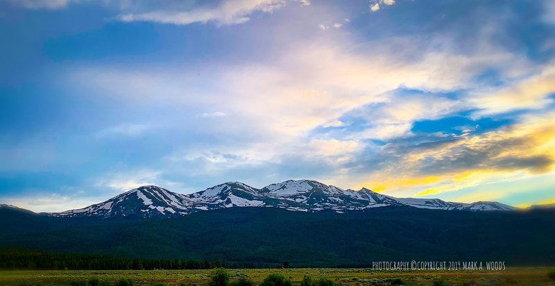 Mount Massive, 2ND highest Colorado 14er, still snow capped, second week of July 2019. View looking west from Halfmoon Road after climbing Mount Elbert earlier this day. Mount Massive at #2 ranked is only 6 feet lower than Mount Elbert.