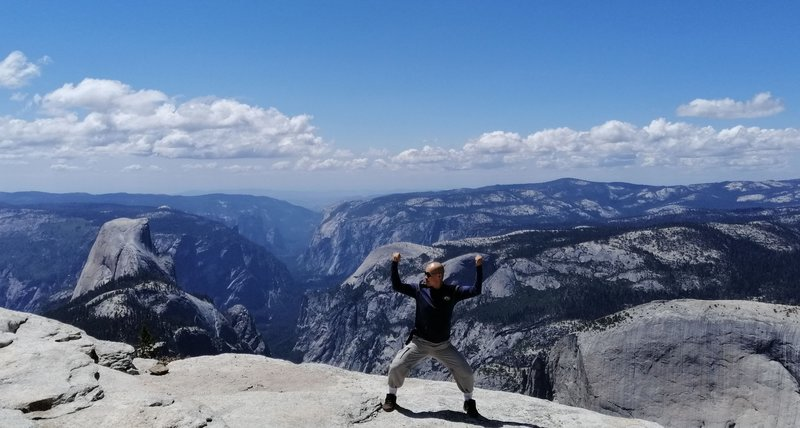 """At the peak of Clouds Rest with the """"Inverse Tunnel View"""" of the Yosemite Valley in the background. he out-and-back hike to Clouds Rest from Tenaya Lake is one of the most rewarding one in Yosemite."""