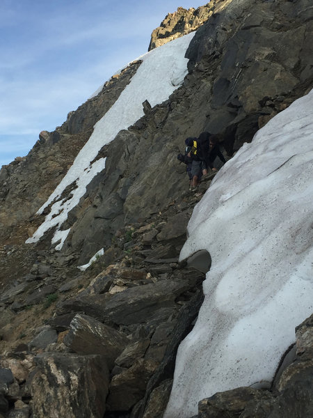 Path as marked from Caribou Pass to Arapahoe Pass is very exposed, narrow, and only suitable for experienced, sure-footed hikers. We turned back rather than risk crossing along steep snowpack,
