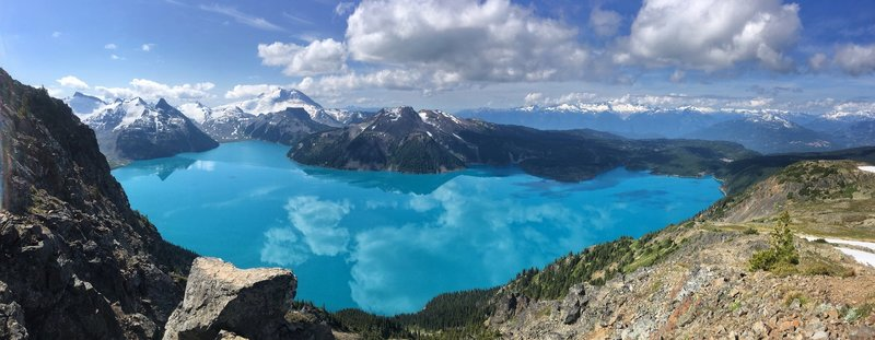 View of Garibaldi Lake from Panorama Ridge Trail. Taken around 10am, no wind and reflection of skies on the still lake