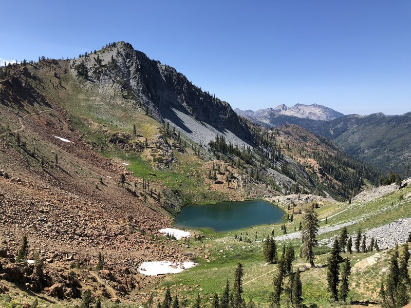 On top of Deer Creek pass, overlooking the first of the four lakes and Siligo peak. The trail continues up to the left of the photo.