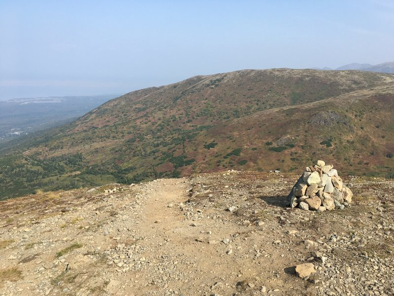 Descending from the top, stay to the right and watch for the rock pile. This is the start of the easy way down.
