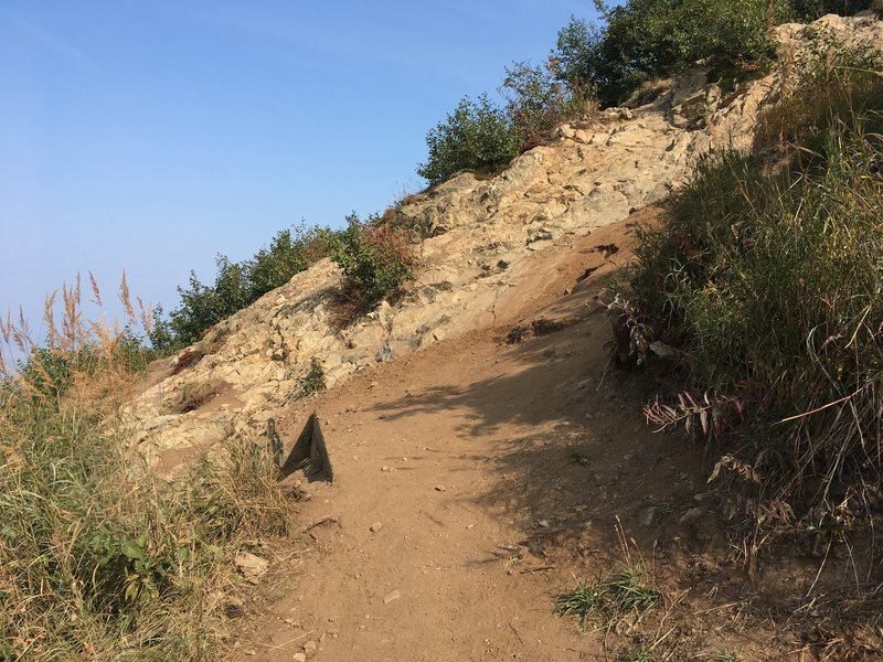 This is the most difficult part of the easy way up and down. As the trail intersects the rock, climb up at a 45-degree angle and find the continuation of the easy up and down trail.