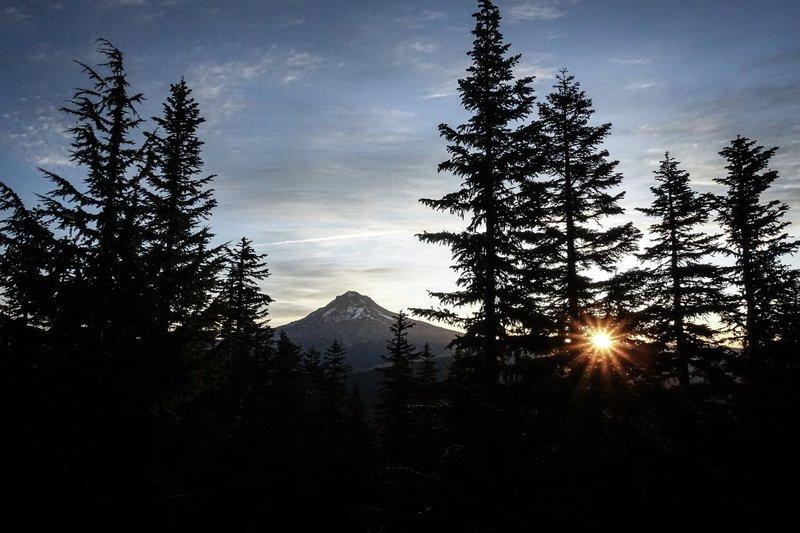 Sun rising near Mt. Hood from Devils Peak Lookout.