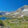 Largest of Pioneer Basin Lakes. Taken from the climb to 6th and 7th lakes. The Third Recess is in the left center with Mt. Mills behind it. The Fourth Recess is on the extreme left.