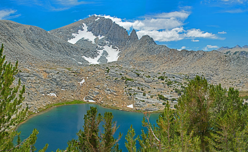 "Largest of the Trail Lakes. The ""Needle"" is on the ridge in the center."