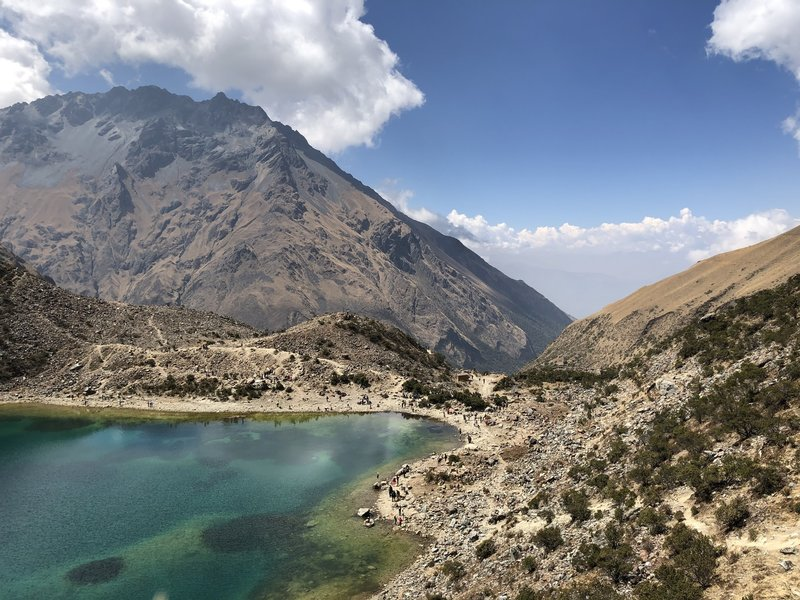 Rear view from Humantay Lake. The Soraypampa Trek to Humantay Lake ends in the right corner, where hikers are stopped for photos.