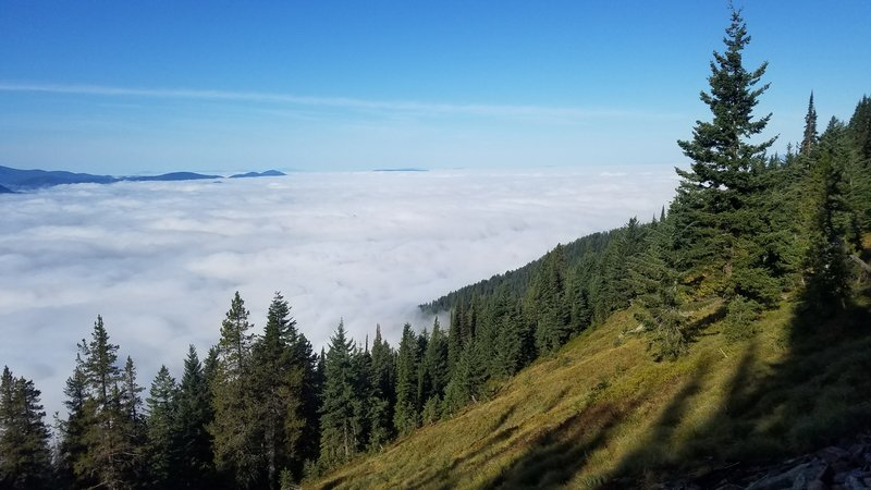 Lake Pend Oreille under a layer of morning fog.
