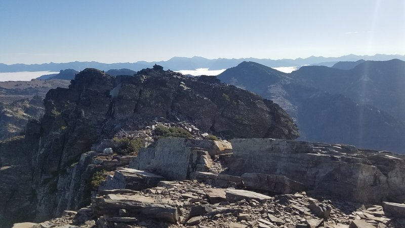 Summit of Scotchman Peak with a mountain goat left-middle.