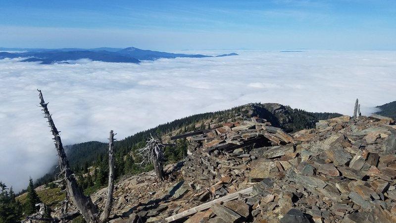 Summit of Scotchman Peak looking back along trail - morning fog below.