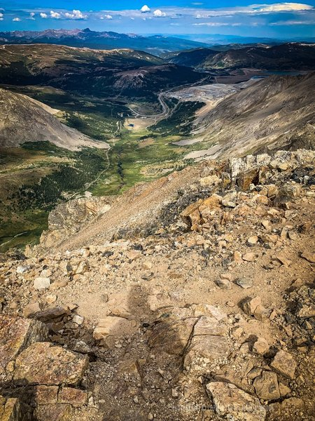View from the Summit of Mount Democrat, 14,148' looking southeast towards the Kite Lake Trailhead, 2200' feet down. That 5.5 mile rutted dirt road from Alma, Colorado gets you here. 2WD not recommended but possible.
