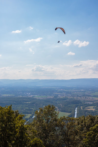 a hang glider seen from the nearby Woodstock Tower