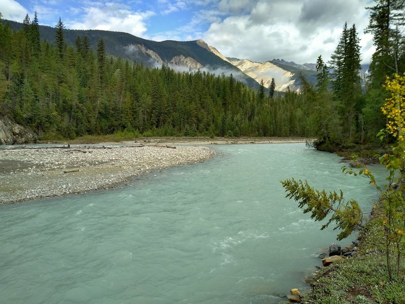 The beautiful, turquoise Blaeberry River in the mountains. Thompson Falls Trail runs next to it here.