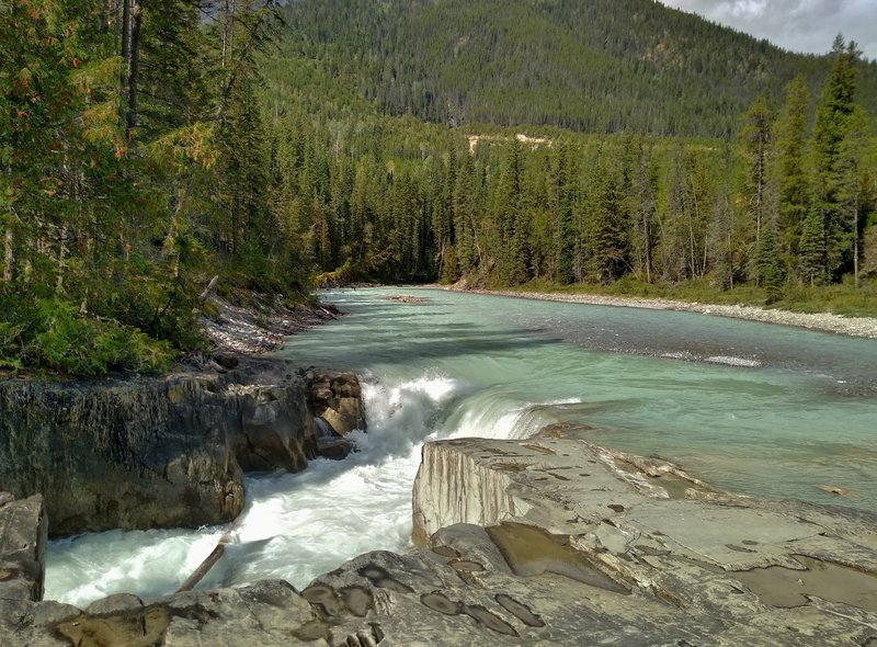 The Blaeberry River plunges over the top cascade of Thompson Falls.