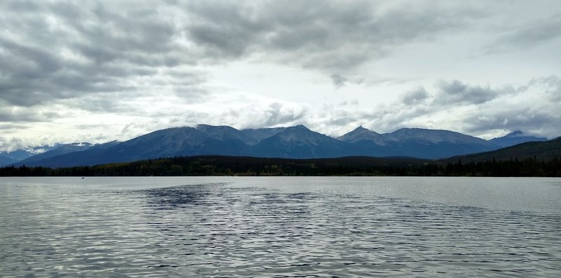 Mountains to the south-southwest, looking across Pyramid Lake from Pyramid Island - (left to right) Whistlers Summit, Indian Ridge, unnamed pointy mountain, Muhigan Mountain and Roche Noire. Mt. Edith Cavell is hidden in the clouds at the far left.