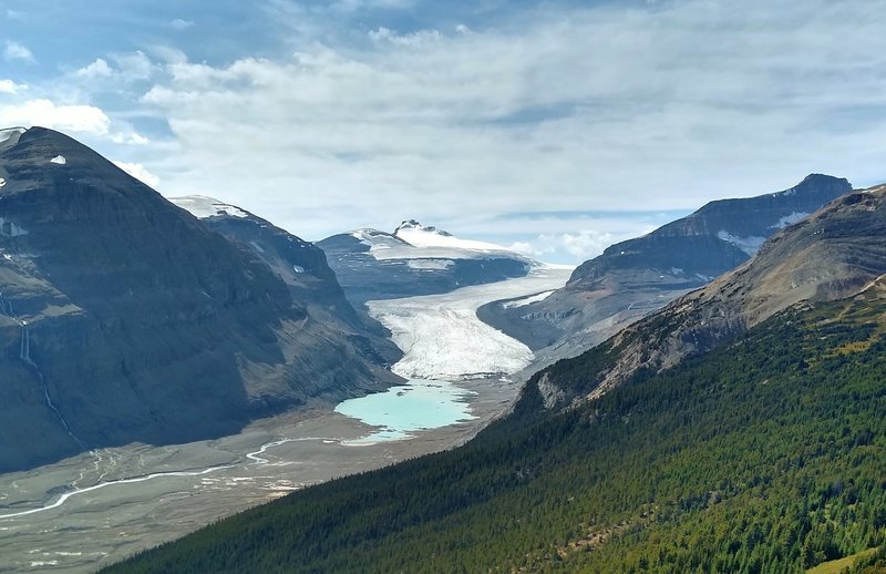 Castleguard Mountain in the distance (center) rises above Saskatchewan Glacier. Melt water from the glacier is the beginning of the North Saskatchewan River.