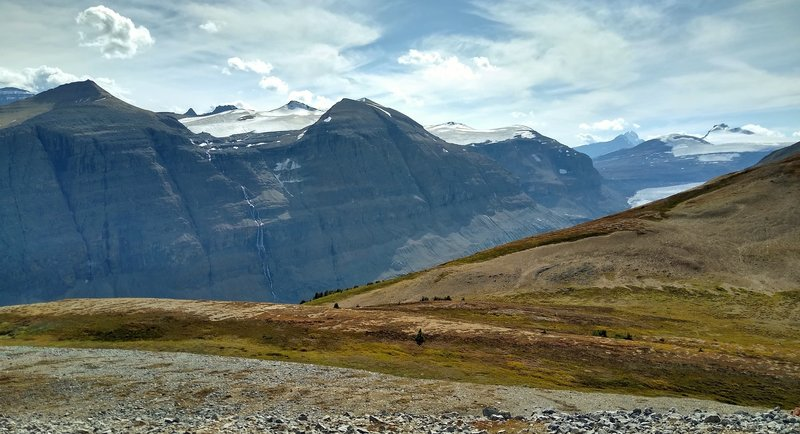 Hidden, the Saskatchewan Glacier and North Saskatchewan River run down the deep valley. Mount Saskatchewn peeks out in the distance on the far left. Castleguard Mountain is in the distance on the far right. Seen looking southwest from Parker Ridge Spur.