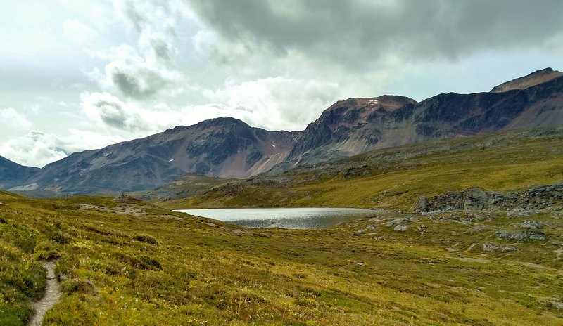 The Endless Chain Ridge and the small lake at Maligne Pass, are seen from the north end of the pass.